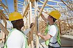 Two construction workers measuring building framework Stock Photo - Premium Royalty-Free, Artist: Cultura RM, Code: 693-06016740