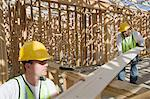 Two construction workers measuring wooden plank Stock Photo - Premium Royalty-Free, Artist: Cultura RM, Code: 693-06016745