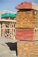 Wooden planks stacked on construction site Stock Photo - Premium Royalty-Freenull, Code: 693-06016754