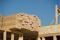 Wooden planks stacked on house construction Stock Photo - Premium Royalty-Freenull, Code: 693-06016781