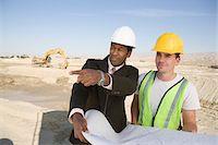 Surveyor and construction worker holding blueprint Stock Photo - Premium Royalty-Freenull, Code: 693-06016793