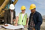 Surveyor and construction workers on site Stock Photo - Premium Royalty-Free, Artist: Transtock, Code: 693-06016807