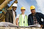 Surveyor and construction workers on site, portrait Stock Photo - Premium Royalty-Free, Artist: Robert Harding Images, Code: 693-06016808