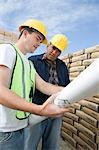 Two construction workers studying blueprints Stock Photo - Premium Royalty-Free, Artist: Robert Harding Images, Code: 693-06016815