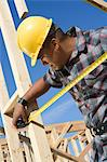 Construction worker measuring half constructed wall with tape measure Stock Photo - Premium Royalty-Free, Artist: Cultura RM, Code: 693-06016877
