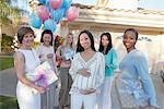 Group of friends with gifts for baby shower outside house Stock Photo - Premium Royalty-Freenull, Code: 693-06017141