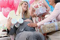 pregnant low angle - Friends giving gifts to woman at baby shower Stock Photo - Premium Royalty-Freenull, Code: 693-06017146