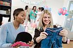 Women at a Baby Shower with baby Clothes Stock Photo - Premium Royalty-Free, Artist: Blend Images, Code: 693-06017177