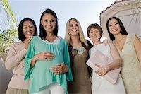 pregnant low angle - Women standing outside celebrating a Baby Shower Stock Photo - Premium Royalty-Freenull, Code: 693-06017192