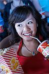 Young Woman Drinking Soda, Watching Movie in movie theatre Stock Photo - Premium Royalty-Free, Artist: CulturaRM, Code: 693-06017219