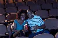 Couple Watching Movie Stock Photo - Premium Royalty-Freenull, Code: 693-06017220