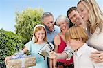 Smiling Family standing outside, Filming a Celebration Stock Photo - Premium Royalty-Free, Artist: Blend Images, Code: 693-06017225