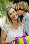 Mid-adult woman receiving birthday present from her son Stock Photo - Premium Royalty-Free, Artist: Blend Images, Code: 693-06017282