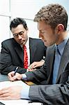 Two Businessmen in Meeting, signing contract Stock Photo - Premium Royalty-Free, Artist: Blend Images, Code: 693-06017307
