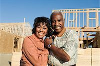 Middle-aged couple in front of home construction site, portrait Stock Photo - Premium Royalty-Freenull, Code: 693-06017373