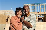 Middle-aged couple in front of home construction site, portrait Stock Photo - Premium Royalty-Free, Artist: Andrew Kolb, Code: 693-06017373