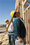 Construction workers holding planks Stock Photo - Premium Royalty-Free, Artist: Albert Normandin, Code: 693-06017387