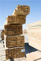 Stacks of planks for new house Stock Photo - Premium Royalty-Freenull, Code: 693-06017396