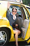 Young businesswoman disembarking from taxi Stock Photo - Premium Royalty-Free, Artist: Aflo Relax, Code: 693-06017537