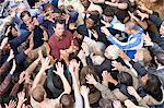 Young man surrounded by crowd Stock Photo - Premium Royalty-Free, Artist: Blend Images, Code: 693-06017582