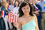 Young woman holding American flag, portrait Stock Photo - Premium Royalty-Free, Artist: Water Rights, Code: 693-06017586