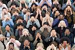 Crowd covering eyes Stock Photo - Premium Royalty-Free, Artist: Blend Images, Code: 693-06017603