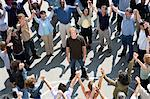 Crowd with arms raised surrounding young man Stock Photo - Premium Royalty-Free, Artist: GreatStock, Code: 693-06017622