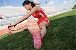 Female athlete stretching Stock Photo - Premium Royalty-Free, Artist: CulturaRM, Code: 693-06017727