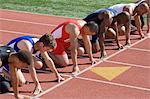 Athletes ready to run, high angle view Stock Photo - Premium Royalty-Free, Artist: Blend Images, Code: 693-06017819