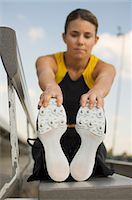 sole - Female track athlete stretching Stock Photo - Premium Royalty-Freenull, Code: 693-06017841