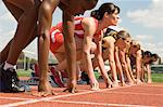 Group of female track athletes on starting blocks Stock Photo - Premium Royalty-Free, Artist: ableimages, Code: 693-06017861