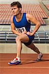 Runner on a track, stretching Stock Photo - Premium Royalty-Free, Artist: Aflo Relax, Code: 693-06017894