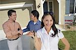 Couple with keys to new home Stock Photo - Premium Royalty-Free, Artist: ableimages, Code: 693-06017927