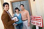 Mid adult couple with estate agent n front of their new home Stock Photo - Premium Royalty-Free, Artist: RelaXimages, Code: 693-06017981