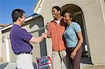 Couple shaking hands with estate agent outside their new home Stock Photo - Premium Royalty-Free, Artist: Robert Harding Images, Code: 693-06018029