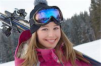 Teenage girl (16-17) holding skis in snow, portrait. Stock Photo - Premium Royalty-Freenull, Code: 693-06018045