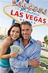 Mid-adult couple in front of Welcome to Las Vegas sign, portrait Stock Photo - Premium Royalty-Free, Artist: Robert Harding Images, Code: 693-06018063