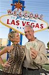 Middle-aged couple in front of Welcome to Las Vegas sign, portrait Stock Photo - Premium Royalty-Free, Artist: photo division, Code: 693-06018071