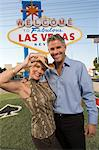 Middle-aged woman and mid-adult man in front of Welcome to Las Vegas sign, portrait Stock Photo - Premium Royalty-Free, Artist: Ed Gifford, Code: 693-06018075