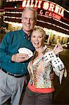 Middle-aged couple in front of casino building, portrait Stock Photo - Premium Royalty-Free, Artist: ableimages, Code: 693-06018095