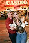 Mid-adult couple in front of casino building, portrait Stock Photo - Premium Royalty-Free, Artist: Jean-Christophe Riou, Code: 693-06018096
