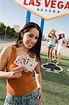 Woman holding cards in front of Las Vegas welcome sign, Nevada, USA Stock Photo - Premium Royalty-Free, Artist: photo division, Code: 693-06018143