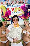 Female dancers and Elvis impersonator posing in front of Las Vegas welcome sign, Nevada, USA Stock Photo - Premium Royalty-Free, Artist: photo division, Code: 693-06018153