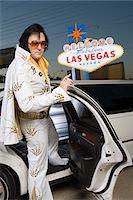 Elvis impersonator getting into limo in Las Vegas, Nevada, USA Stock Photo - Premium Royalty-Freenull, Code: 693-06018161
