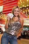 Portrait of young woman holding playing cards in front of illuminated casino, Las Vegas, Nevada, USA Stock Photo - Premium Royalty-Free, Artist: photo division, Code: 693-06018165