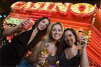 Portrait of three young women toasting in front of illuminated casino, Las Vegas, Nevada, USA Stock Photo - Premium Royalty-Freenull, Code: 693-06018167