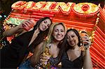 Portrait of three young women toasting in front of illuminated casino, Las Vegas, Nevada, USA Stock Photo - Premium Royalty-Free, Artist: photo division, Code: 693-06018167