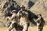 Soldiers carrying rifles in the field Stock Photo - Premium Royalty-Free, Artist: CulturaRM, Code: 693-06018183