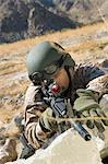 Soldier aiming rifle, outdoors Stock Photo - Premium Royalty-Free, Artist: Garry Black, Code: 693-06018186