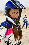 Female motocross racer wearing helmet, outdoors, (portrait) Stock Photo - Premium Royalty-Free, Artist: Aflo Sport, Code: 693-06018227